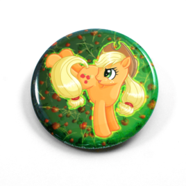 A cute chibi drawing by Camie M. Anderson of Applejack from My Little Pony on a handcrafted button