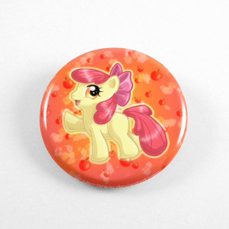 A cute chibi drawing by Camie M. Anderson of Applebloom from My Little Pony on a handmade button