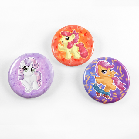 A set of three cute chibi drawings of the Cutie Mark Crusaders on a set of handmade buttons