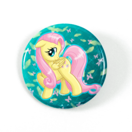 A cute chibi drawing by Camie M. Anderson of Fluttershy from My Little Pony on a handcrafted button