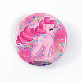 A cute Chibi drawing by Camie M. Anderson of Pinkie Pie from My Little Pony on a handcrafted button