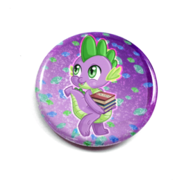 A cute chibi drawing by Camie M. Anderson of Spike from My Little Pony on a hnadcrafted button