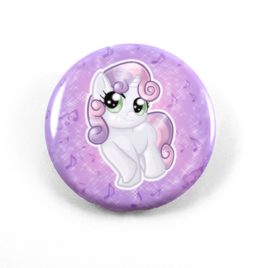 A cute chibi drawing by Camie M. Anderson of Sweetie Belle from My Little pony on a handmade button