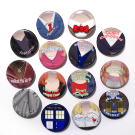 A set of thirteen handmade buttons drawn by Camie M. Anderson of a various characters from Doctor Who