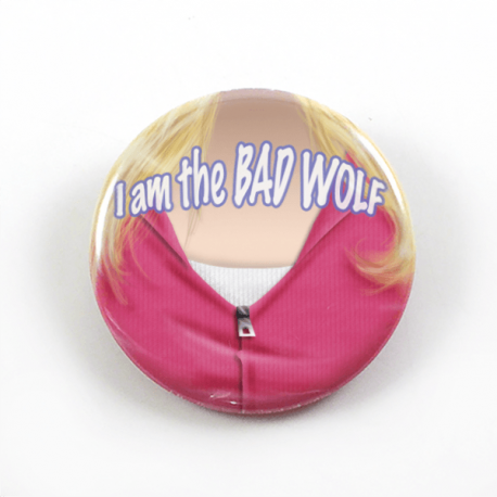 A clever bust portrait by Camie M. Anderson of Rose Tyler from Doctor Who saying her memorable quote I am the bad wolf on a handmade button