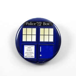 A drawing by Camie M. Anderson of the TARDIS from Doctor Who on a handmade button