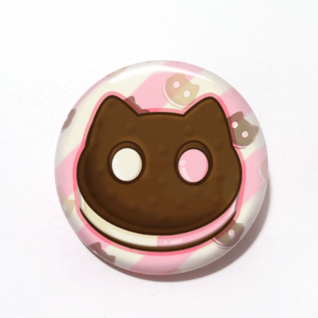 A cute drawing by Camie M. Anderson of a Cookie Cat ice cream sandwhich from Steven Universe on a handmade button