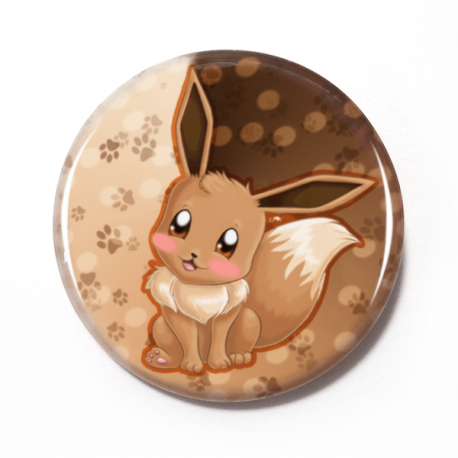 A cute chibi drawing by Camie M. Anderson of Eevee from Pokemon on a handmade button