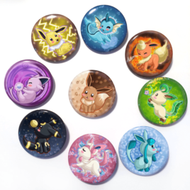 A set of nine handmade buttons of Eevee and all it's evolutions (aka eeveelutions) drawn by Camie M. Anderson