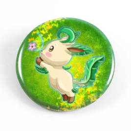 A cute chibi drawing by Camie M. Anderson of Leafeon from Pokemon on a handmade button