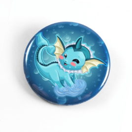 A cute chibi drawing by Camie M. Anderson of Vaporeon from Pokemon on a handmade button