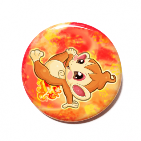A cute chibi version of Chimchar from Pokemon drawn by Camie M. Anderson on a handmade button