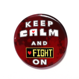 A handmade button inspired by the Genocide route from Unertale