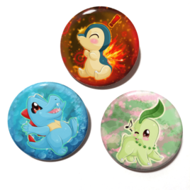 A set of three handmade buttons featuring the Johto starters from Pokemon drawn by Camie M. Anderson