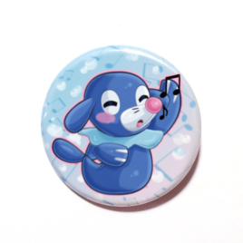A cute chibi version of Popplio from Pokemon drawn by Camie M. Anderson on a handmade button