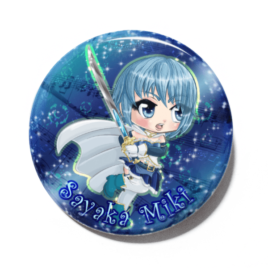 A cute chibi version of Sayaka Miki from Puella Magi Madoka Magica drawn by Camie M. Anderson on a handmade button